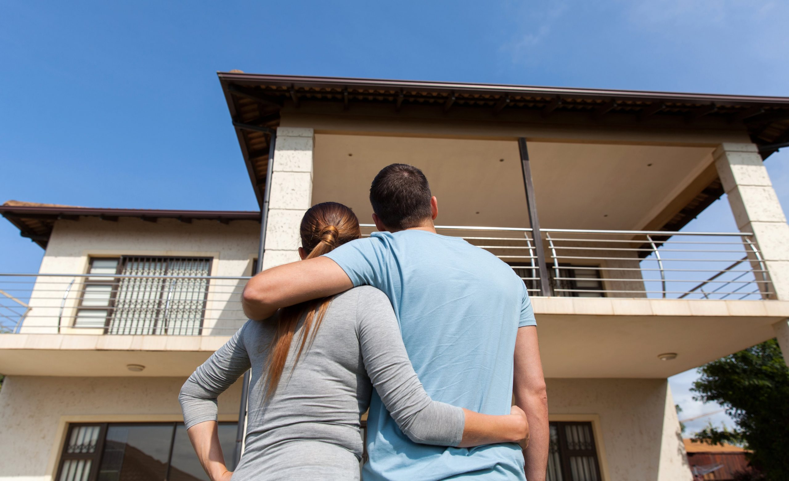 Couple looking at their home: Home Loans Australia
