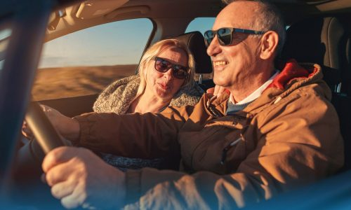 Senior couple driving - life insurance comparison